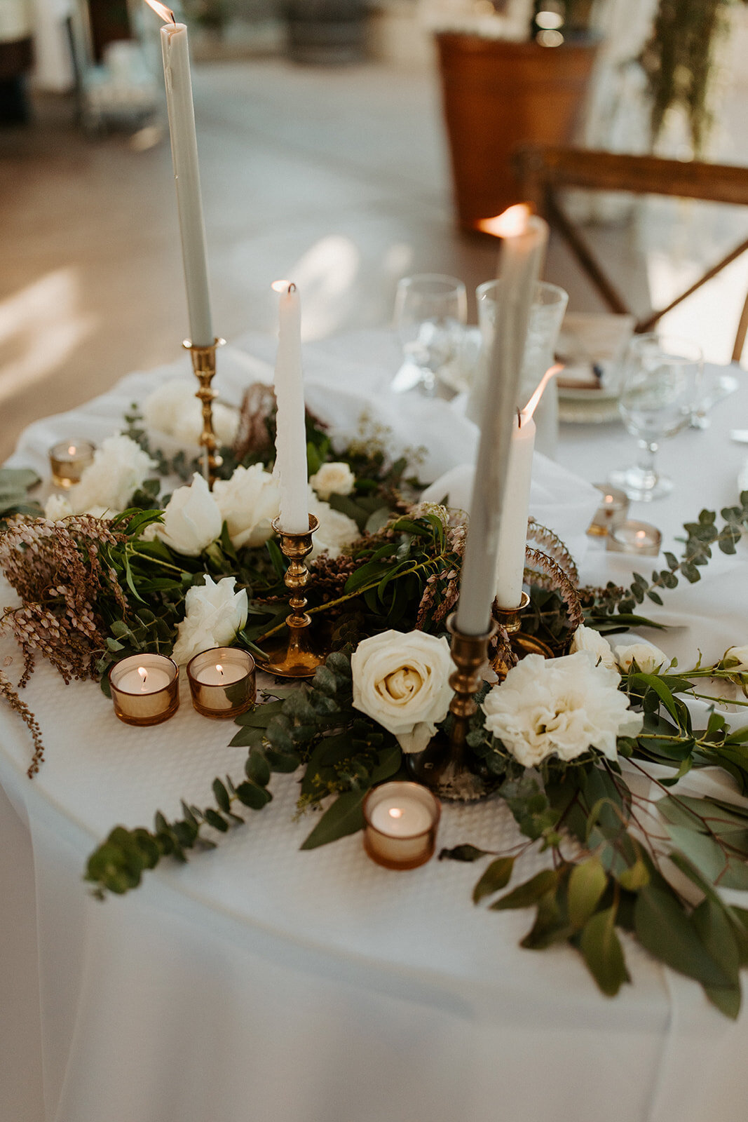 head table decorated with flowers