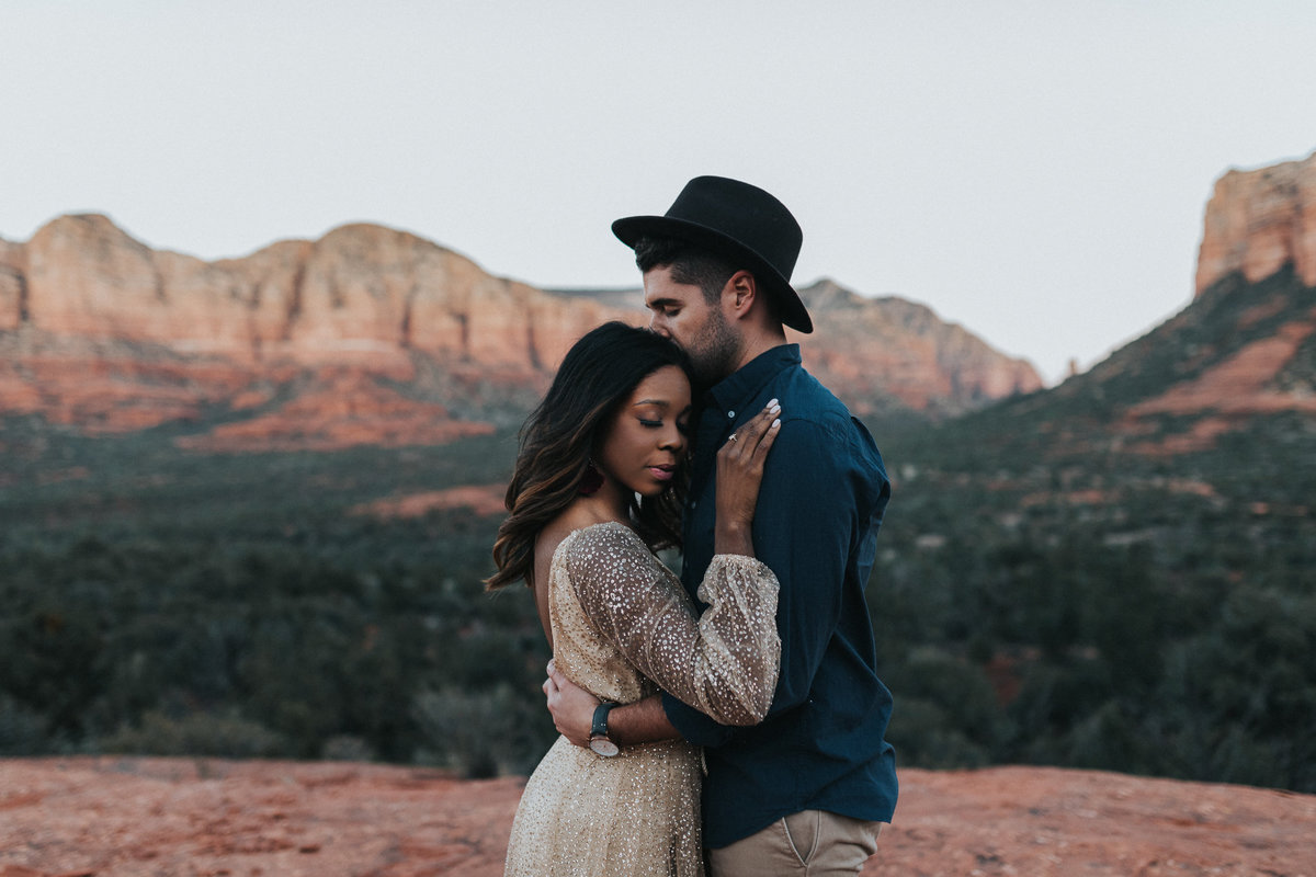 An in love couple during their adventure engagement session in Sedona  Arizona