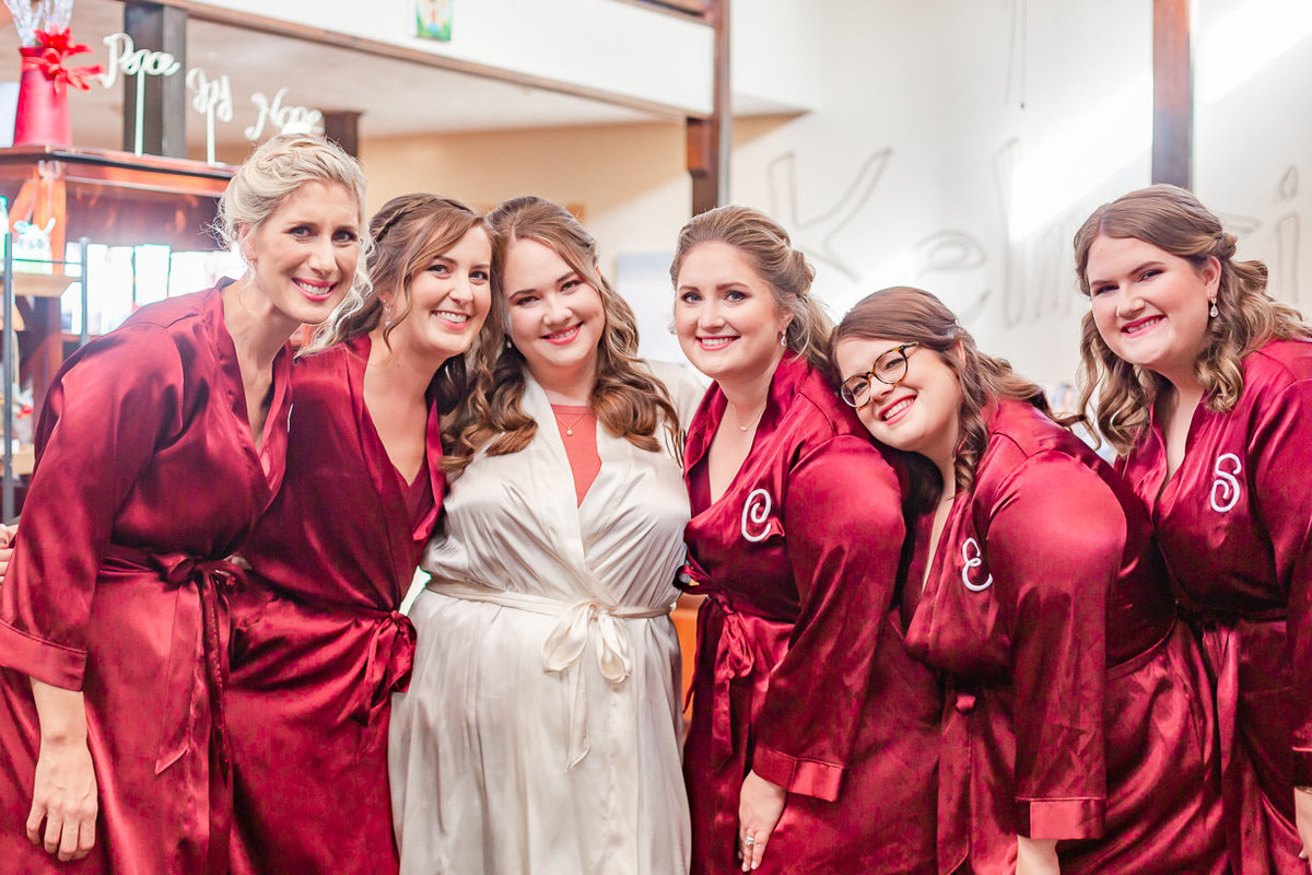 bridesmaids in robes photo | Toni Goodie Photography