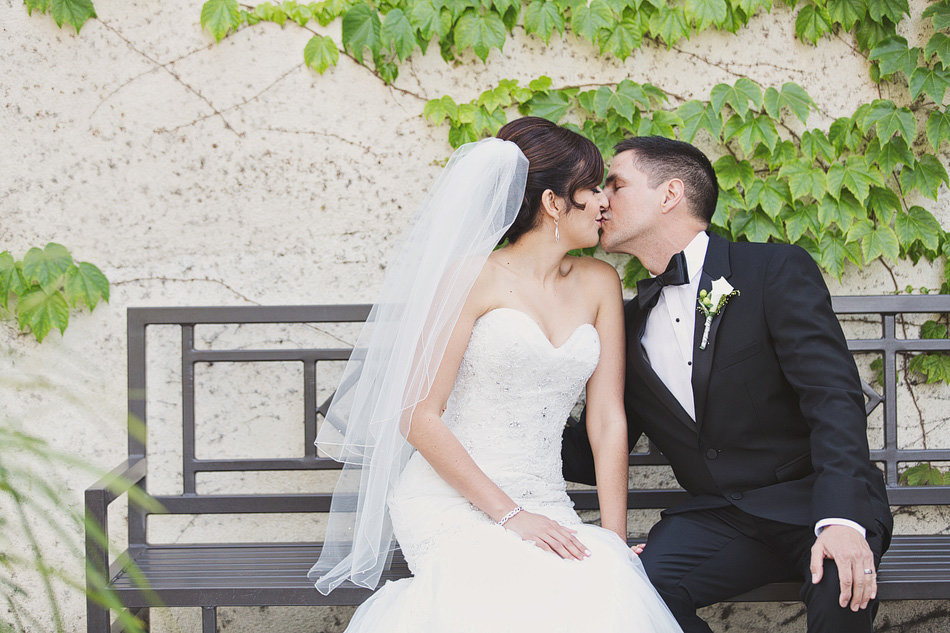 Bride and groom kiss after wedding ceremony in Los Angeles, CA