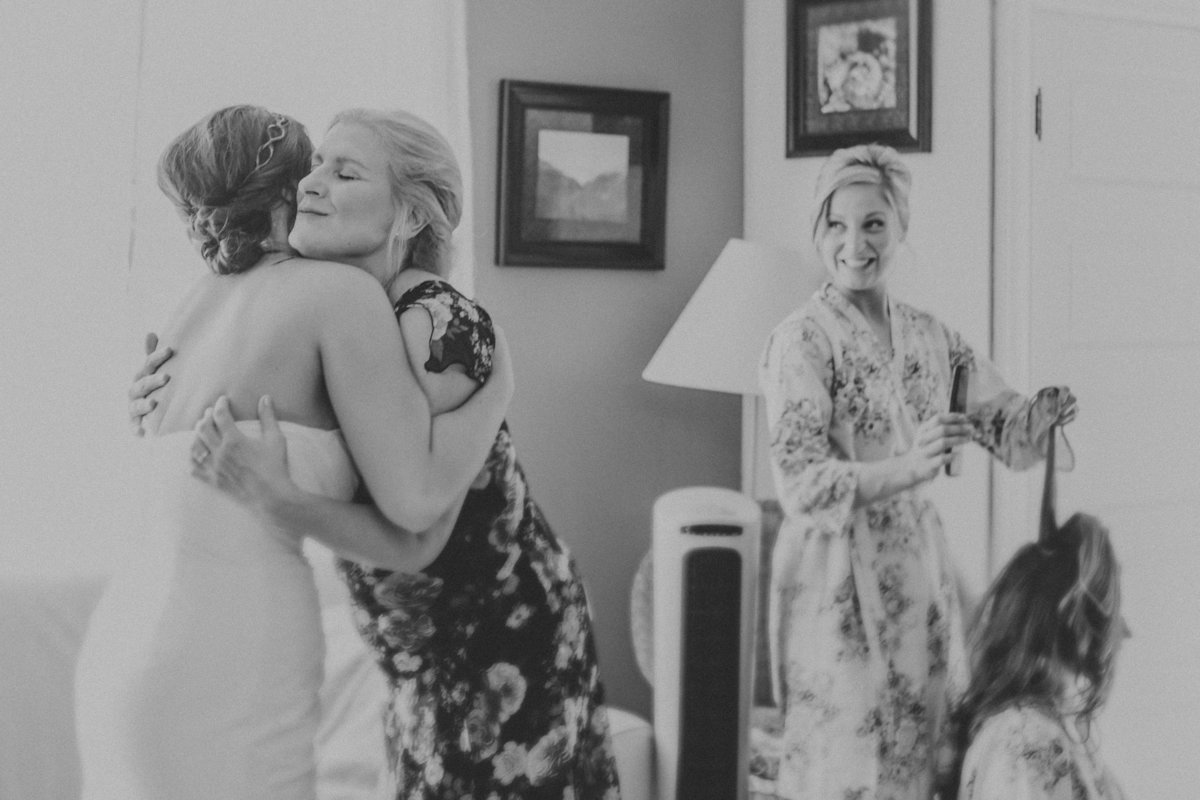 wedding photo of mother of the bride hugging her  daughter | Susie Moreno Photography
