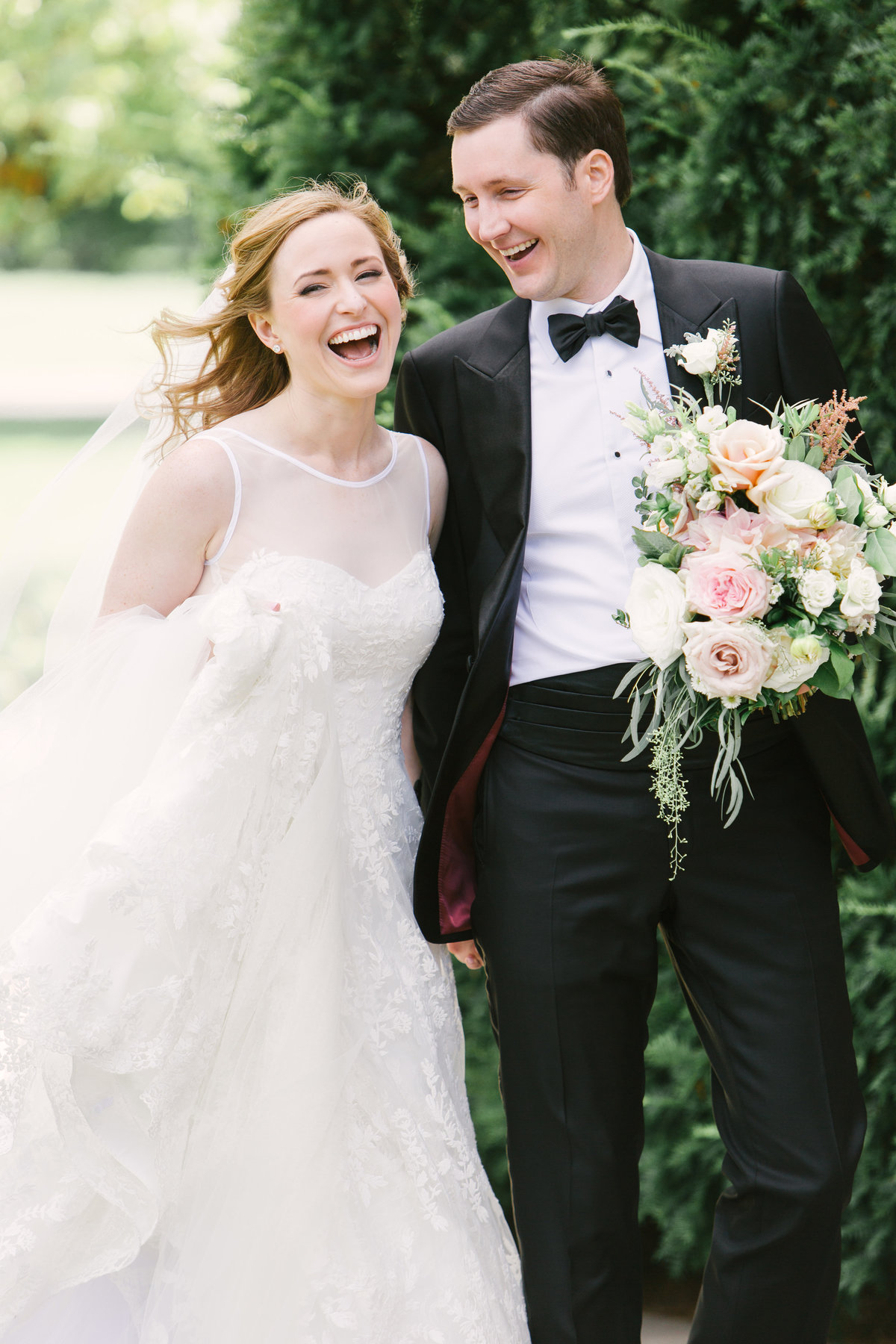 Scottish Rite Cathedral Wedding  Bride and Groom Laughing Photo