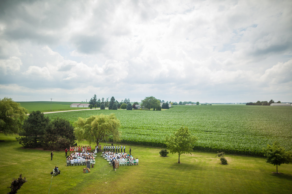 out wedding ceremony at barnacopia in polo illinois