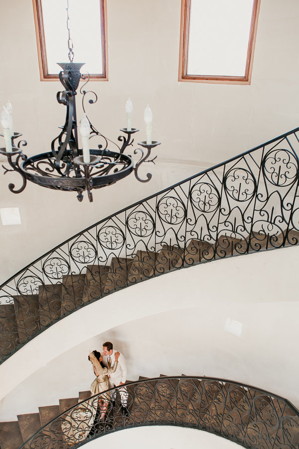 Portrait of bride and groom on the stairs of Malibu Solstice Vineyards