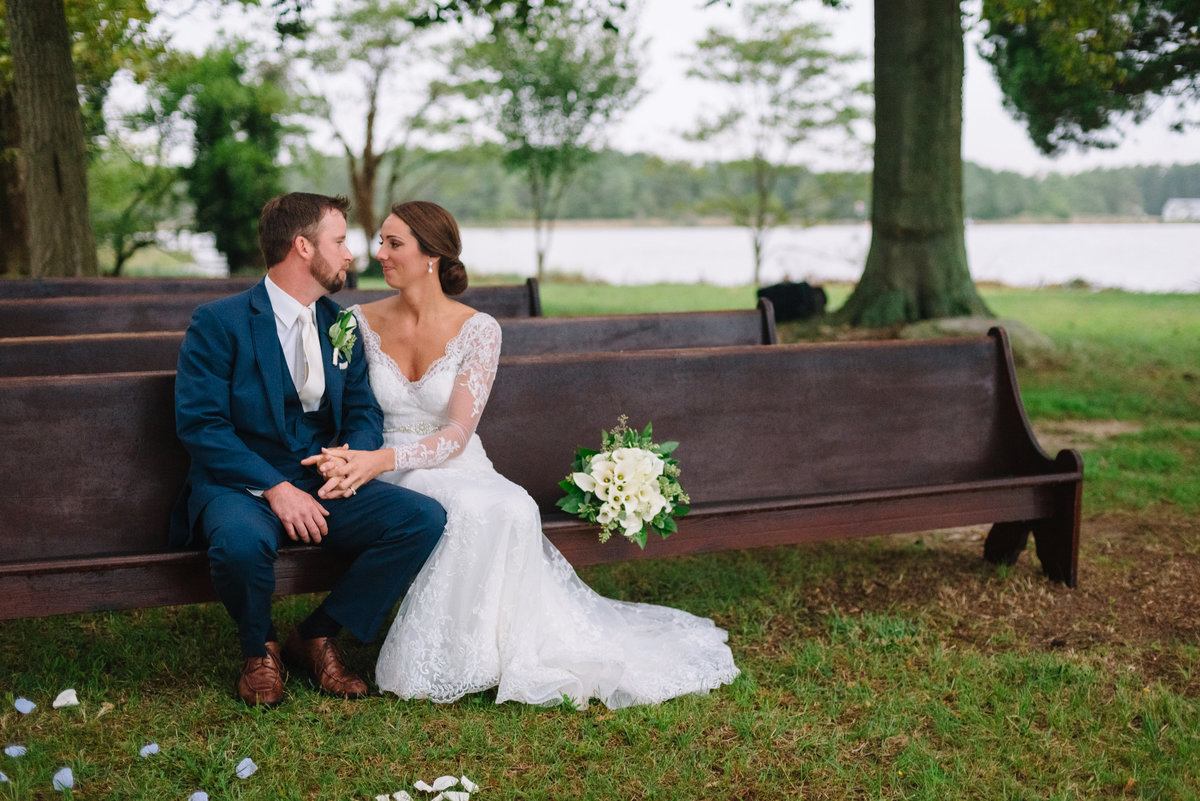 cambridge maryland waterfront wedding photographer bride and groom on bench