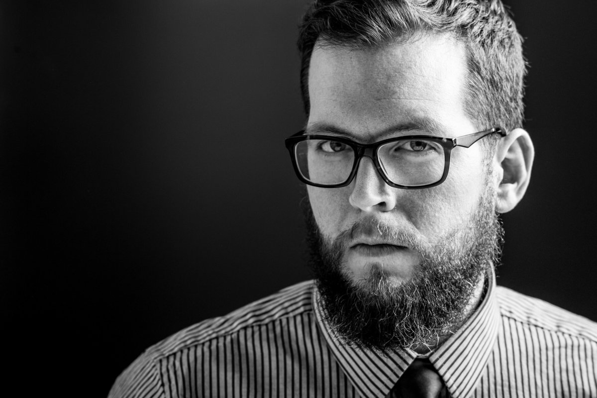 Portrait of Chicago man, beard and glasses, shirt and tie.