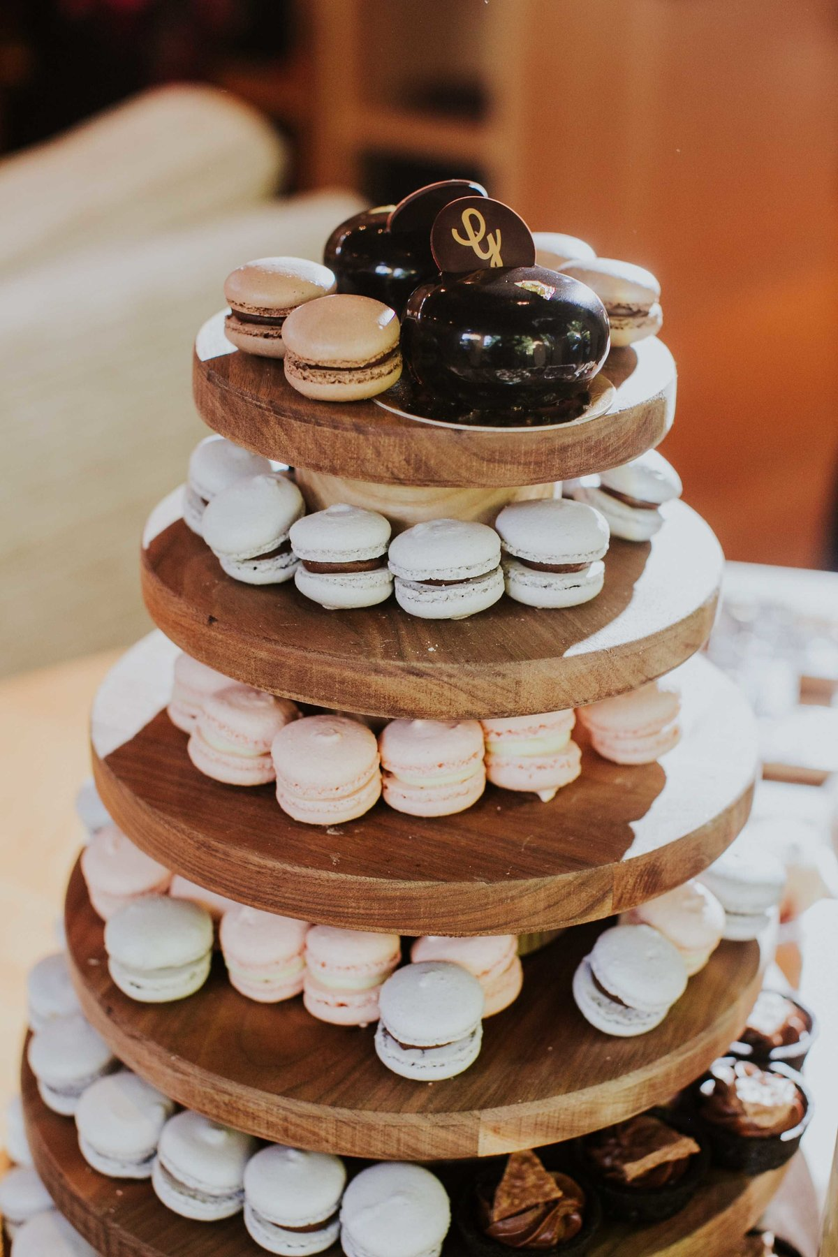 Gallery Pastry Shop macaroons sit on wooden tower at indianapolis backyard wedding