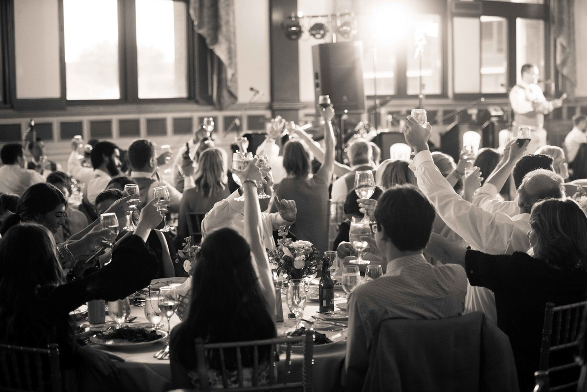 Guests toast to bride and groom at wedding reception, Chicago IL.