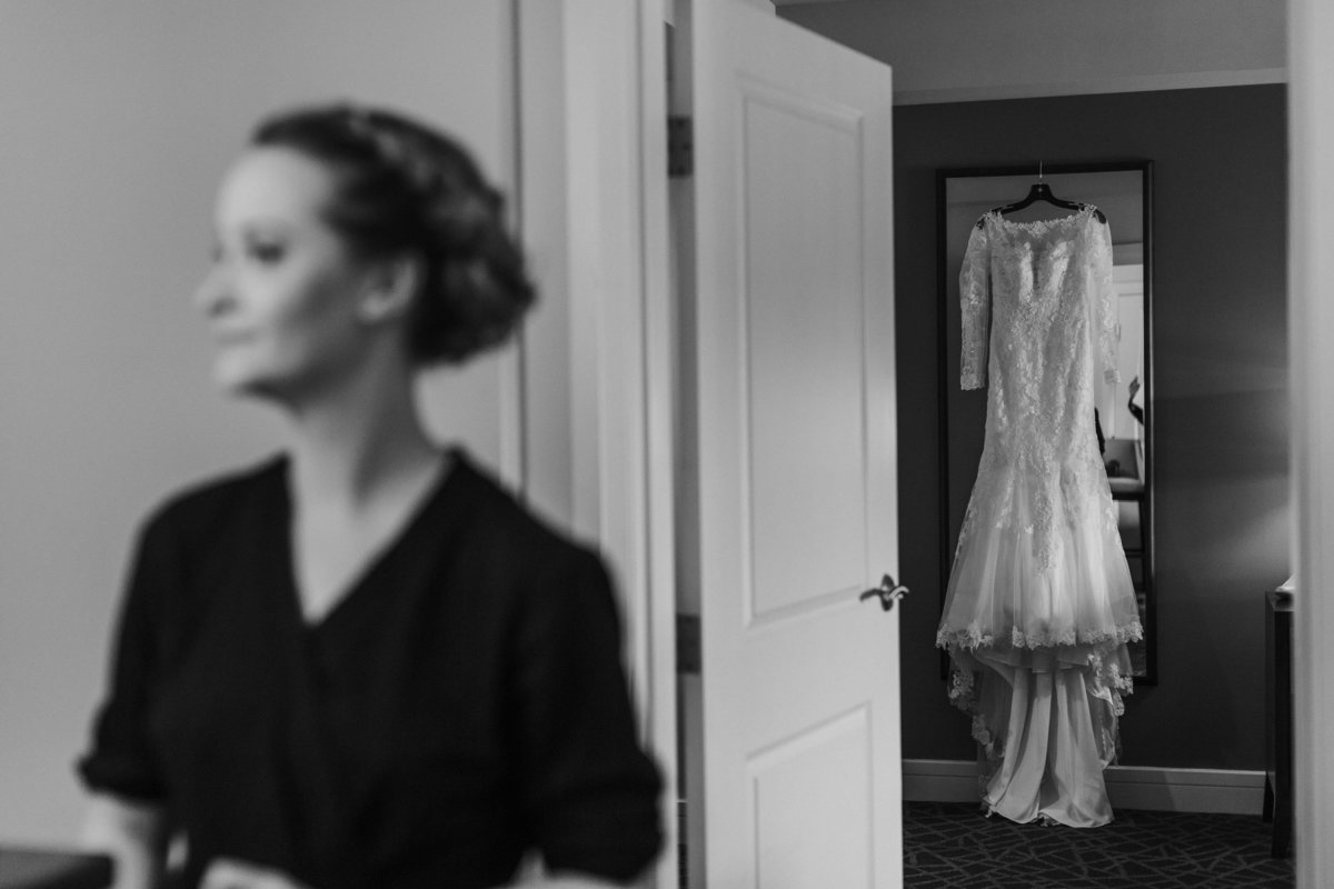 beautiful bride waits to put her dress on in victoria bc wedding