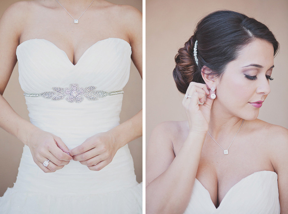 details of a bride's dress, wedding ring and jewelry