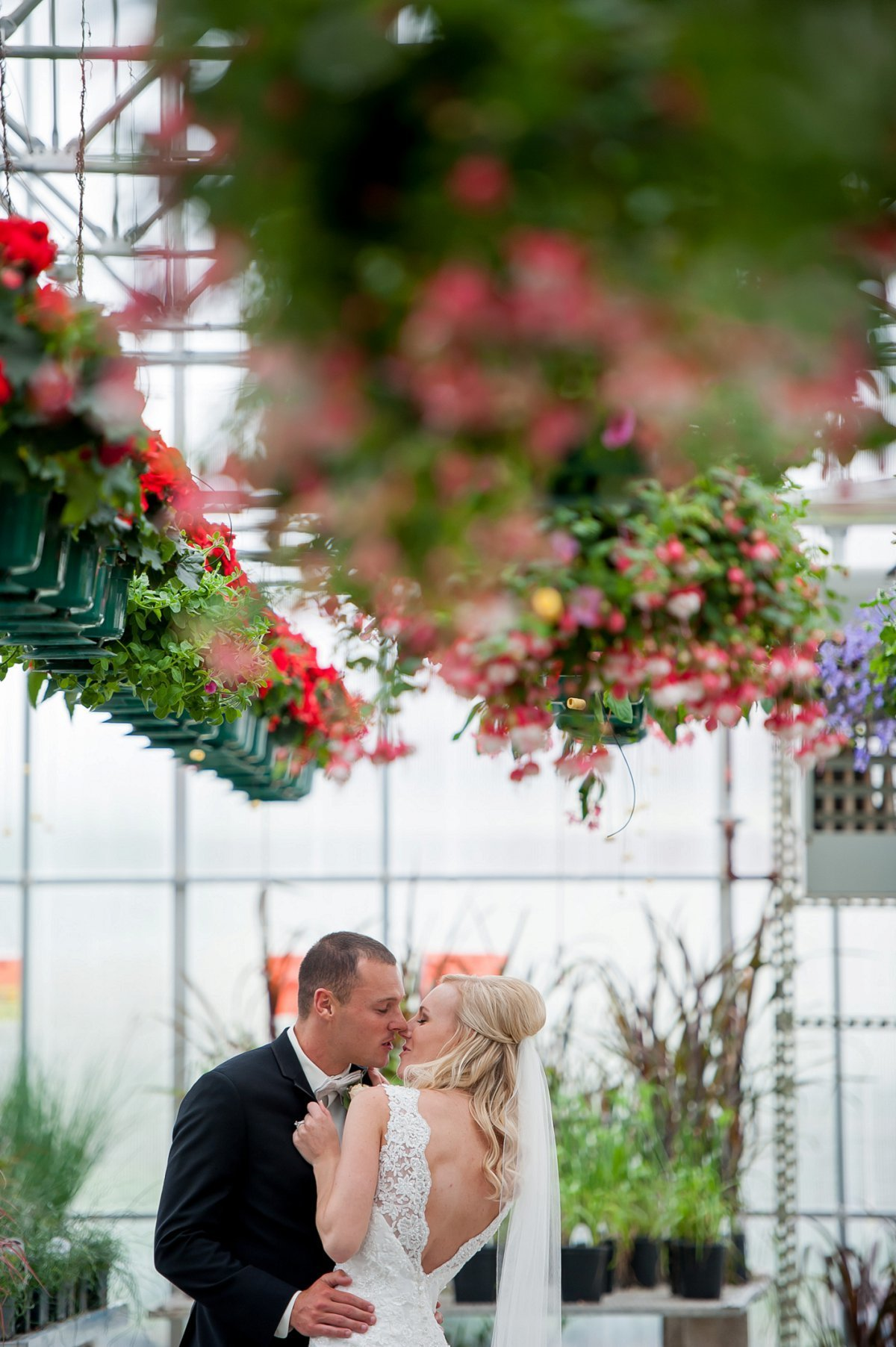 Wedding portraits in a greenhouse, boho modern weddings photography by Kriskandel