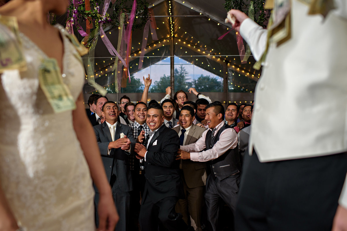 Single men line up to catch the garter during a mexican wedding  at Pearl S Buck Estate.