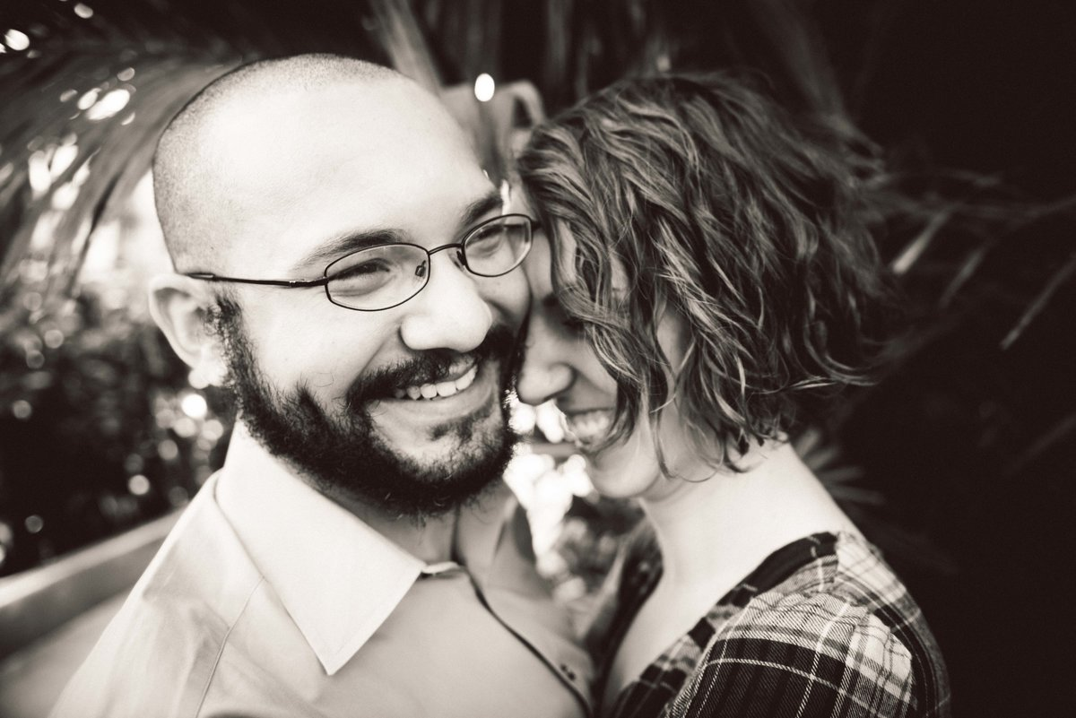 Close-up, couples laughs during engagement session, Chicago IL.
