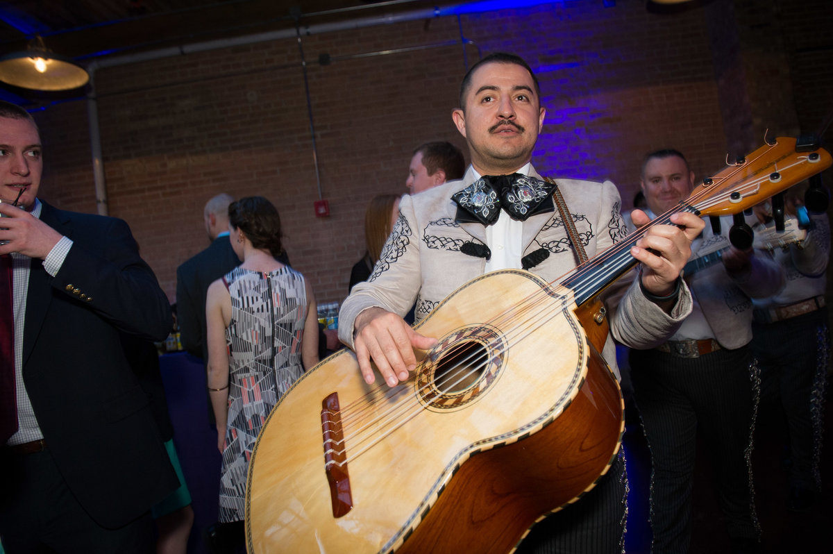Mariachi band makes its entrance at Chicago fundraising event.