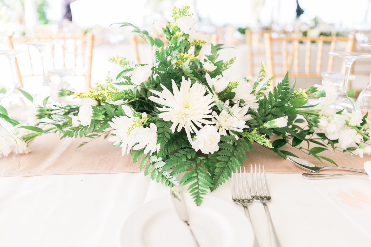 White and green wedding centerpieces in Barbados