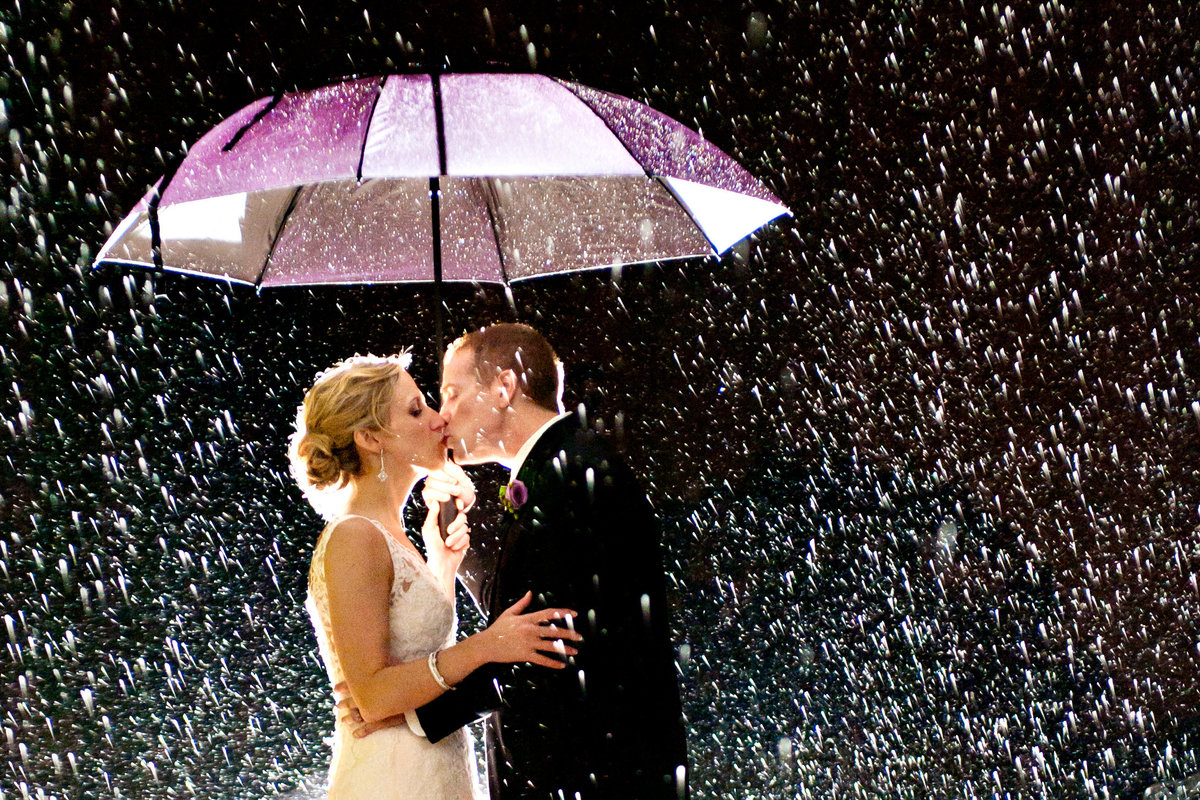 A newly married couple kiss during the stormy weather of Hurricane Irene.