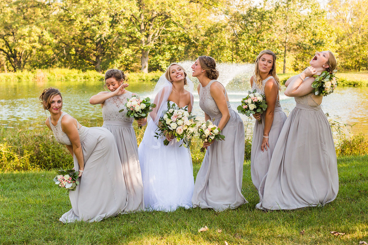 bride with her crazy bridemaids at oak hill