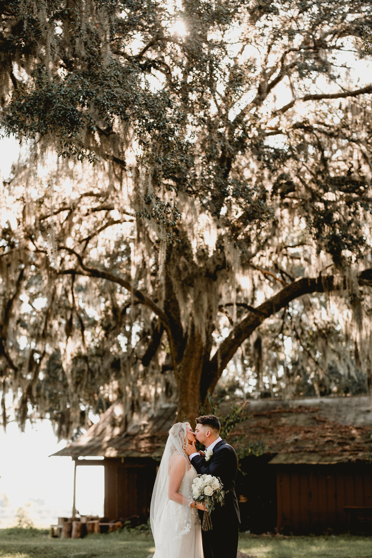 Bride and groom pictures taken after the ceremony by lifestyle wedding photographer at Seven Hills Farm, Fl.