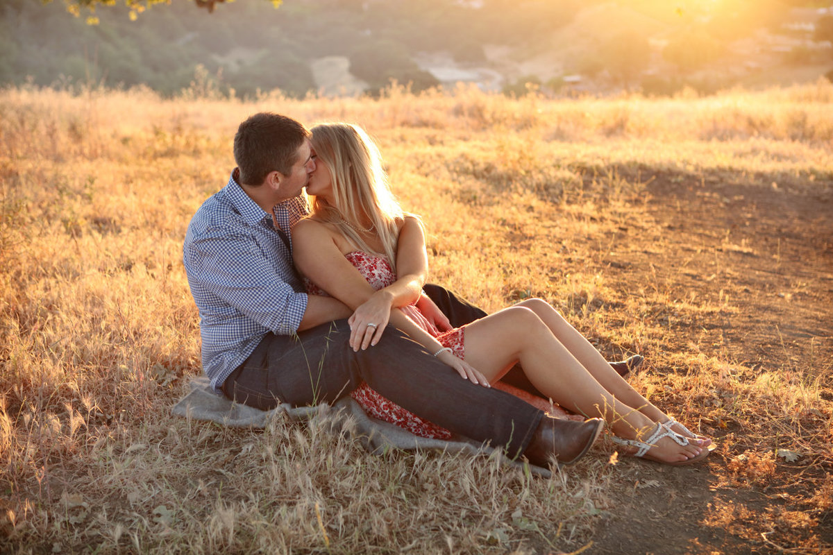 Engagement session portrait couple sitting golden hour love los altos california