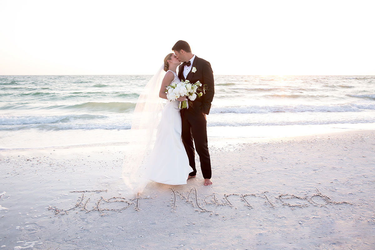marco beach ocean resort wedding photo just married in sand