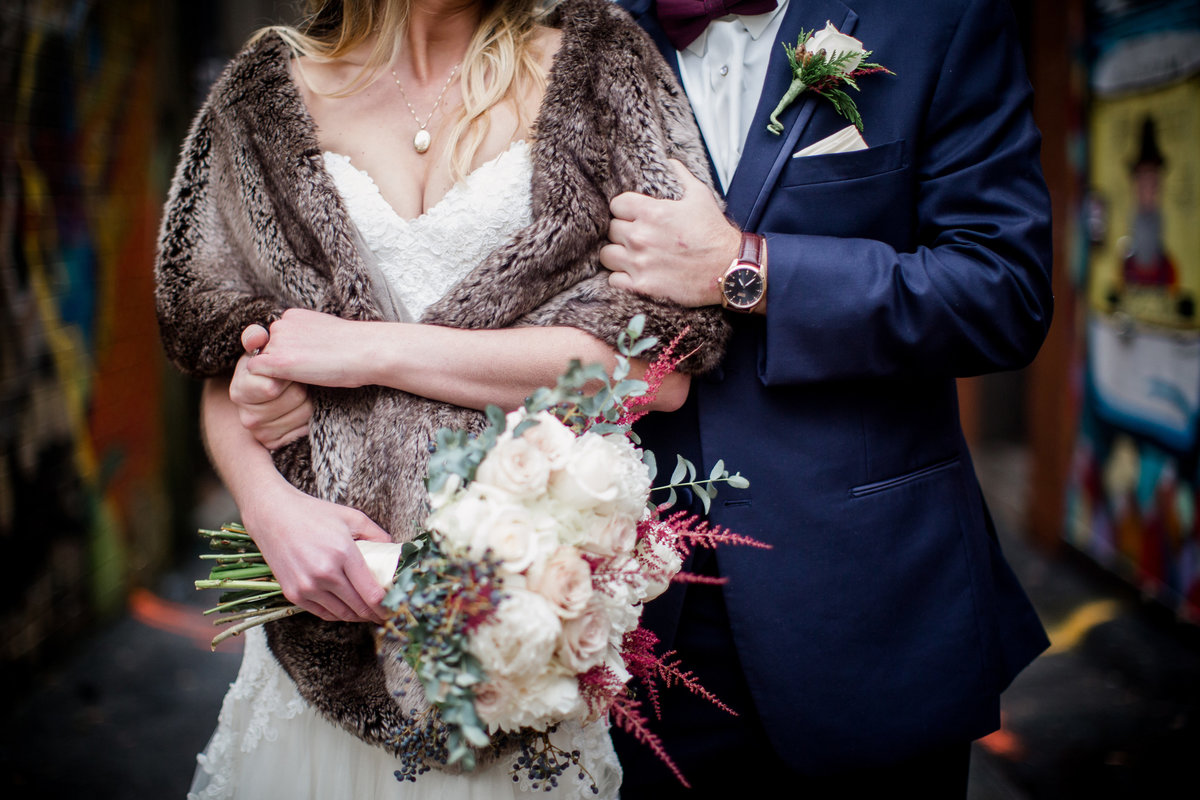 Arms tangled up at Jackson Terminal Wedding Venue by Knoxville Wedding Photographer, Amanda May Photos.