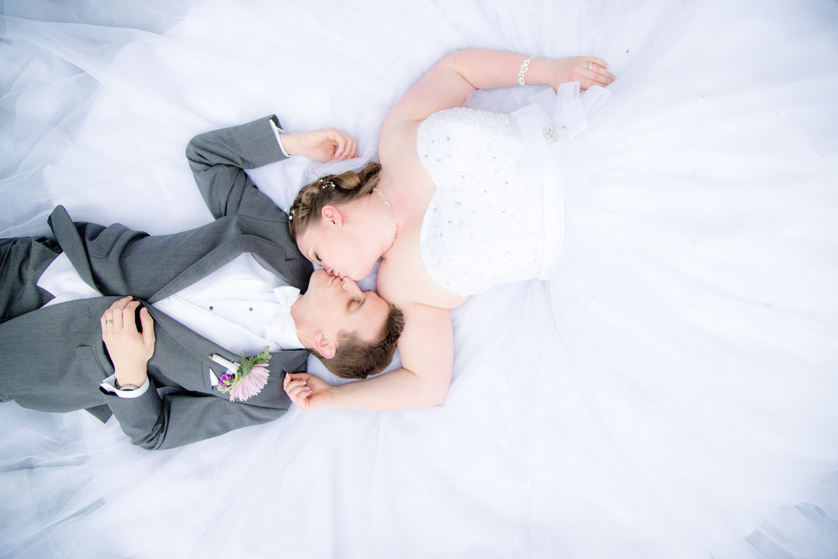 40 wedding photography bride and groom lying down