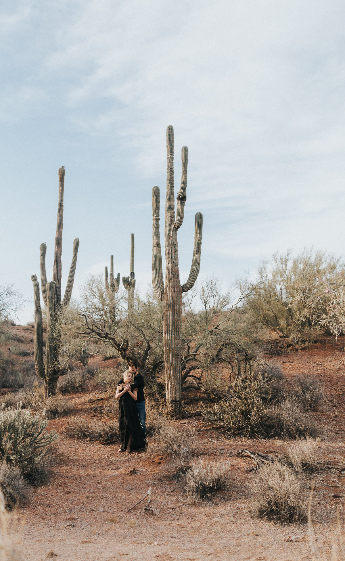An in love couple during their adventure engagement session in Page Arizona