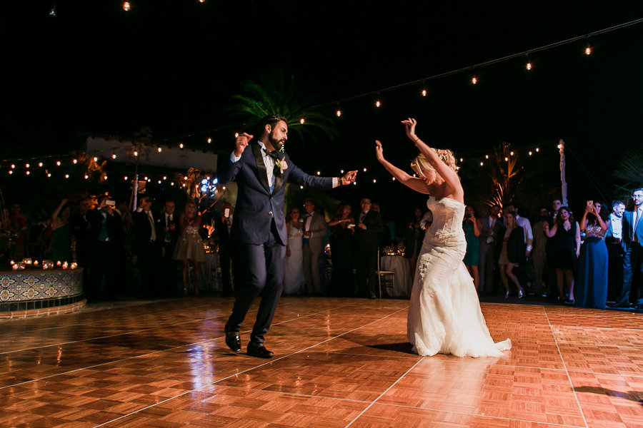 Fun dancing of newly weds at their reception