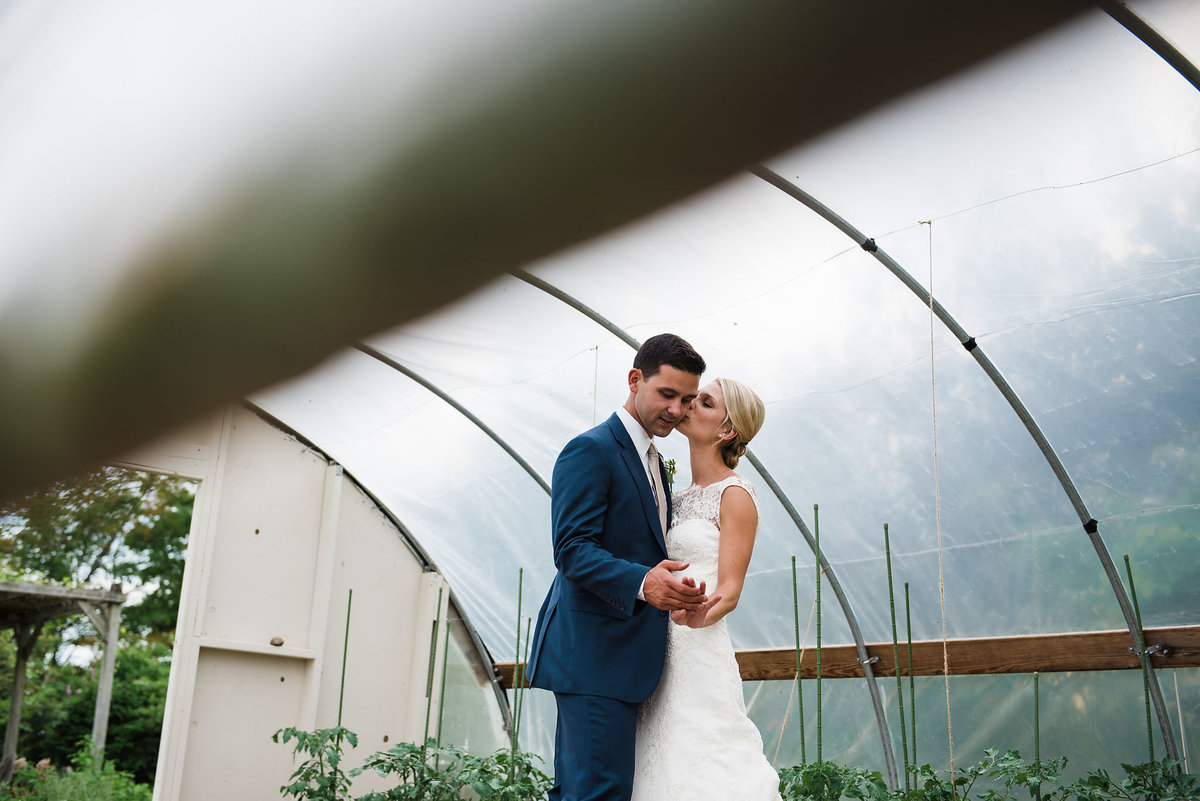 bride and groom in greenhouse, Trapp Family Lodge wedding