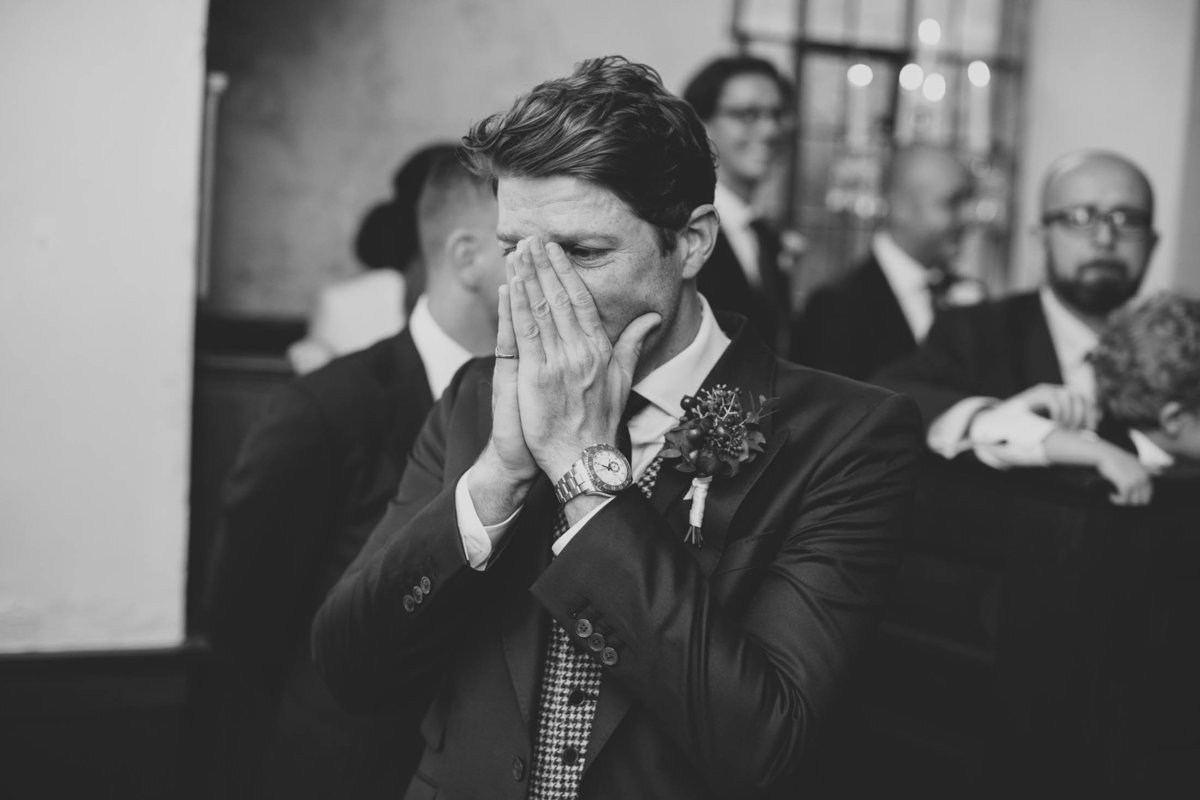the groom emotional in the wedding chapel before the wedding ceremony