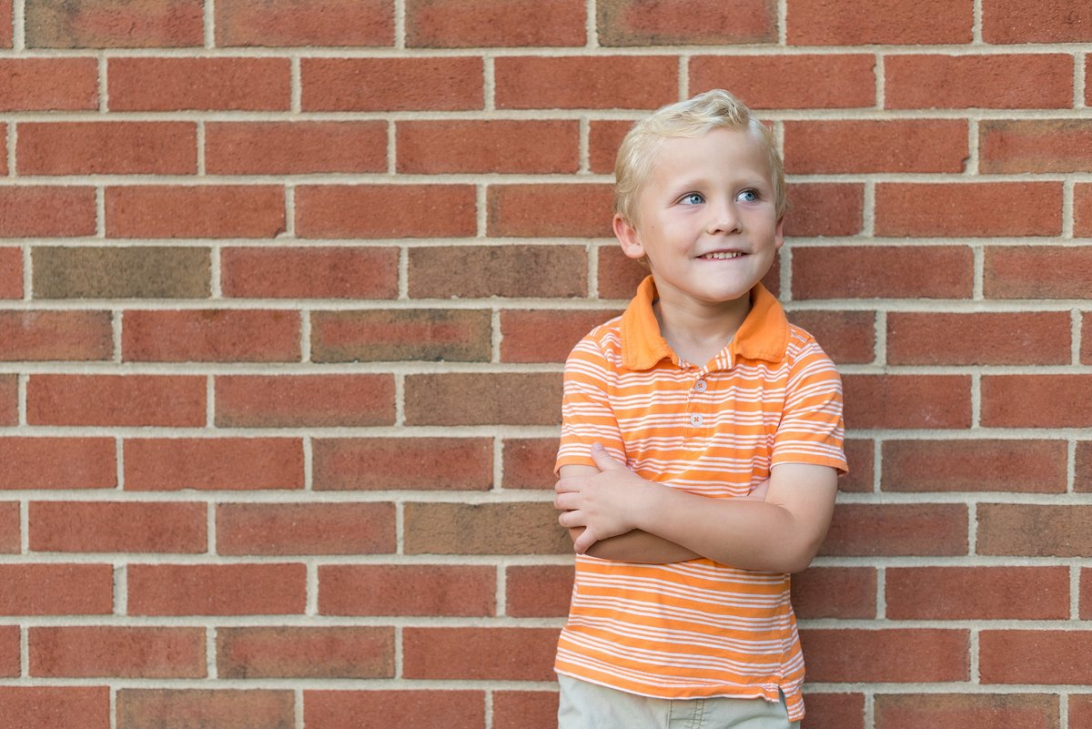 Five Year Old Boy Portrait in front of Brick Wall Photo