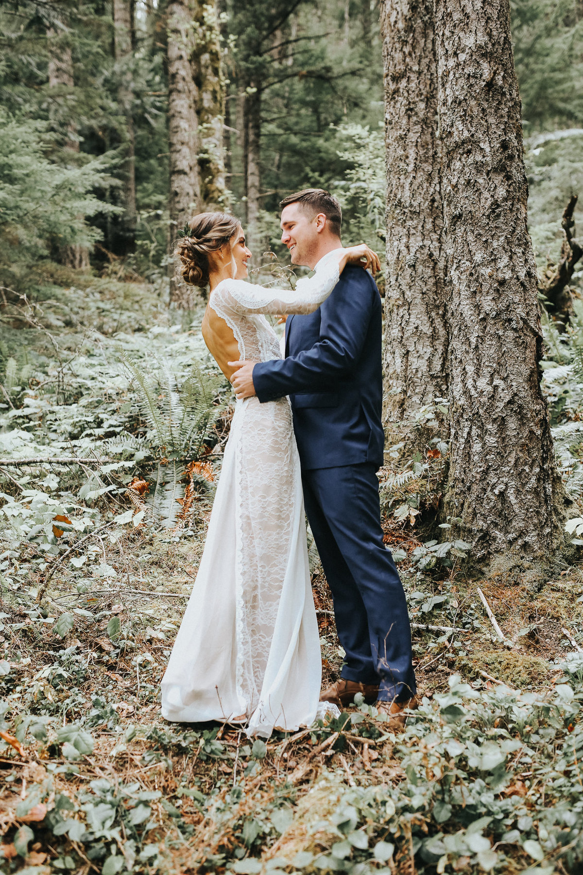 First look with bride and groom in the woods of Port Angeles, Washington