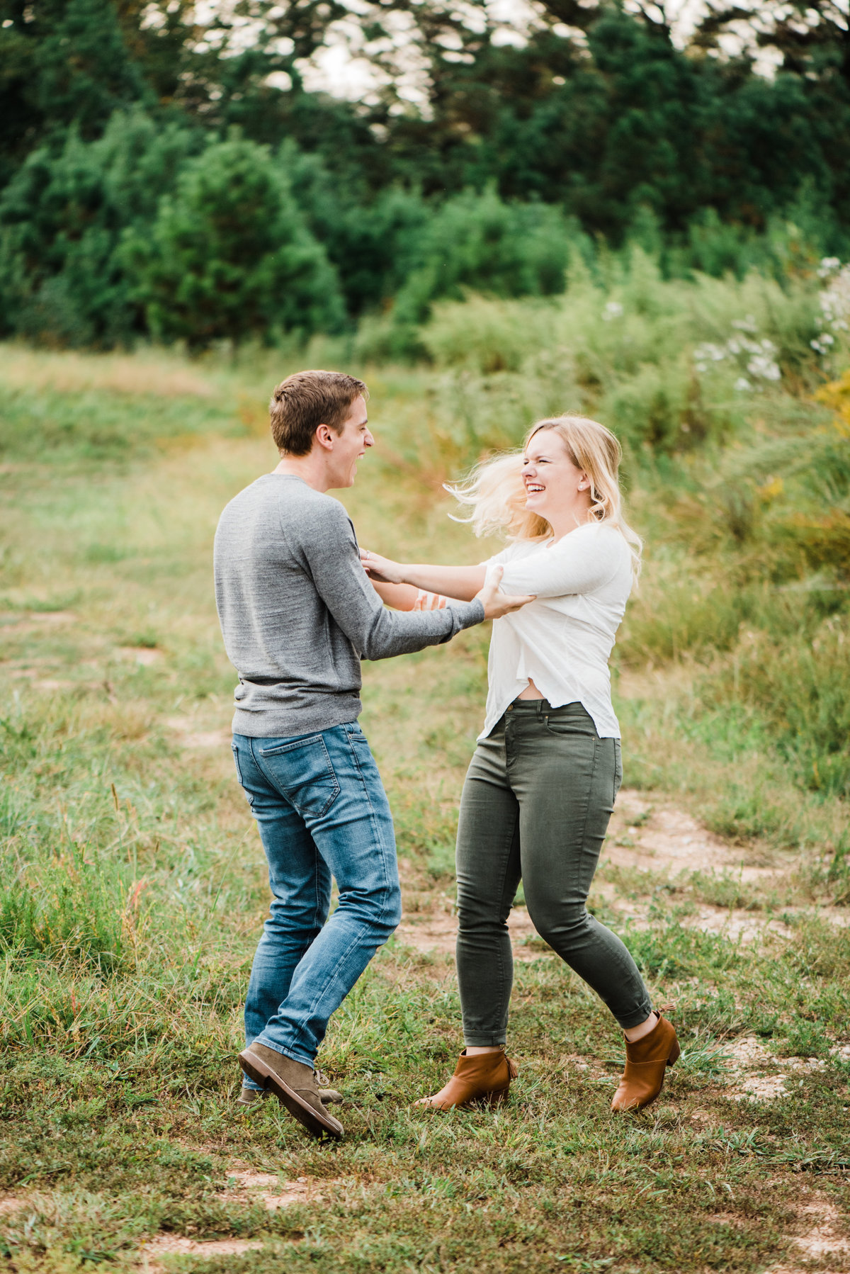 couple playing during their engagement photos photo