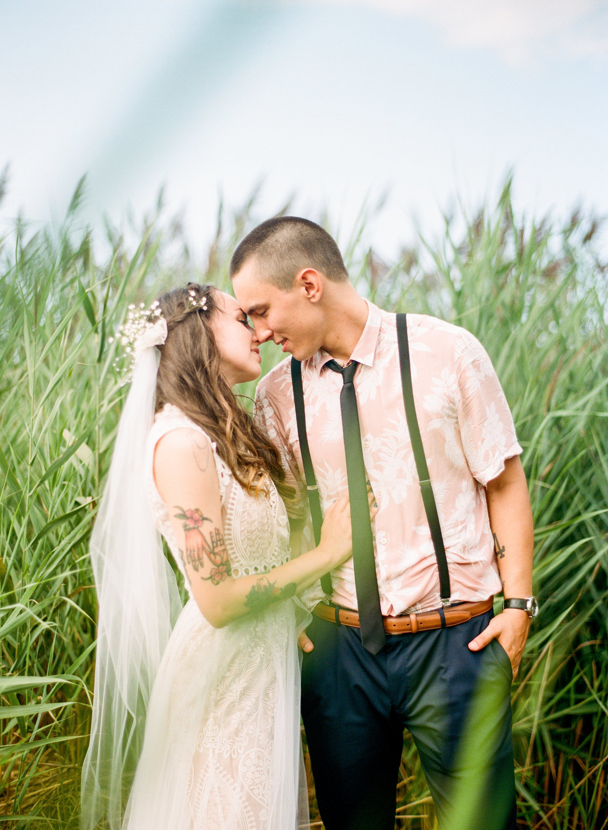cape cod backyard wedding couple kissing