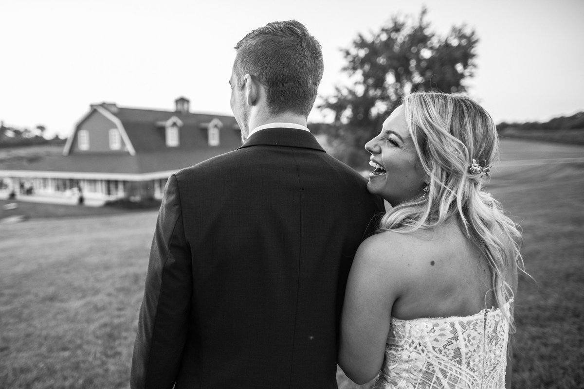 bride laughing with groom at orchard ridge farms the pavilion in rockton illinois
