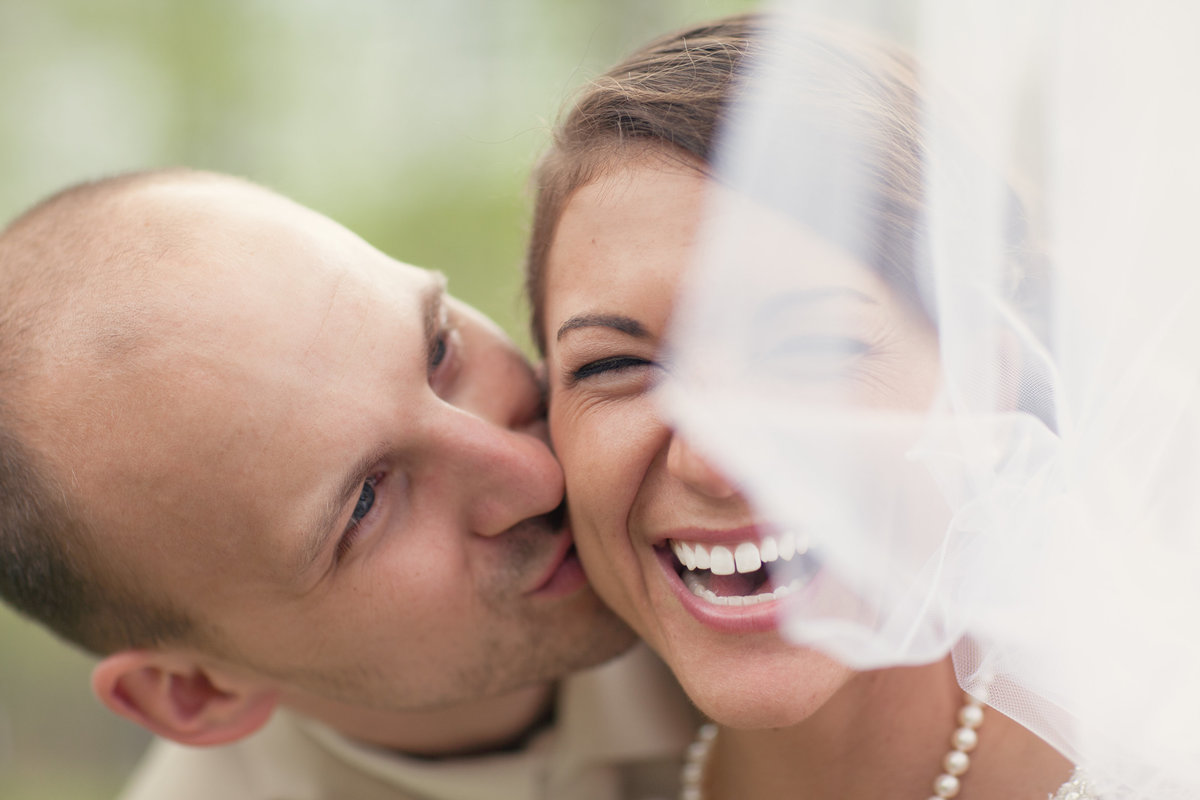 bride and groom laughing at raystown resort wedding by jana scott photography