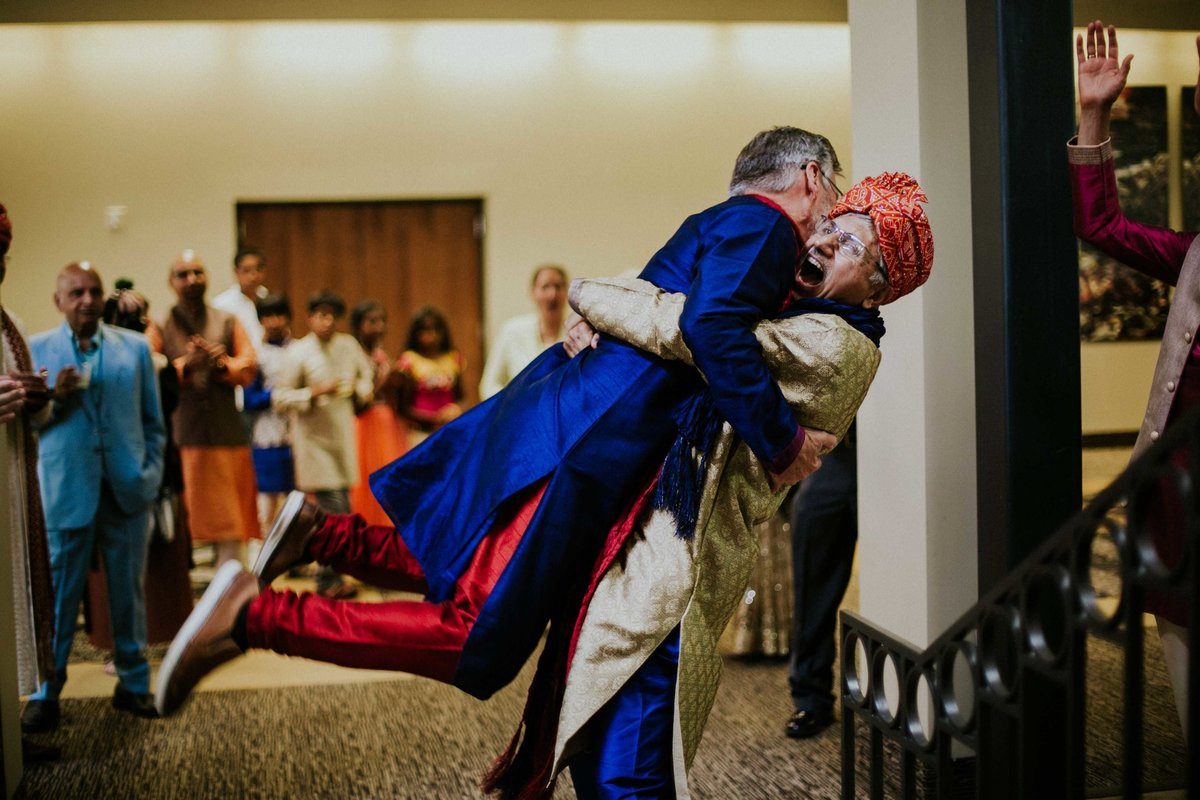 Grooms father picks up brides father at Indian wedding at Horizon Convention Center