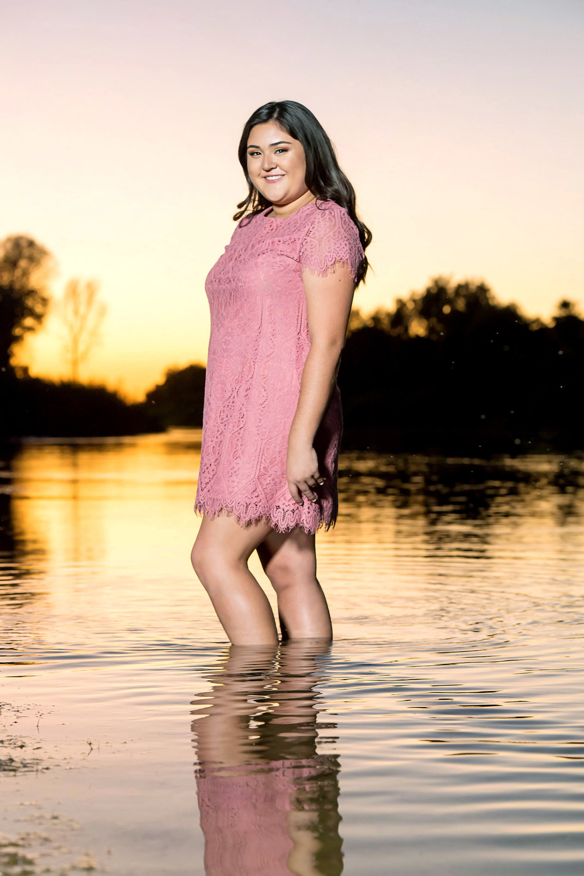 senior with river and sunset