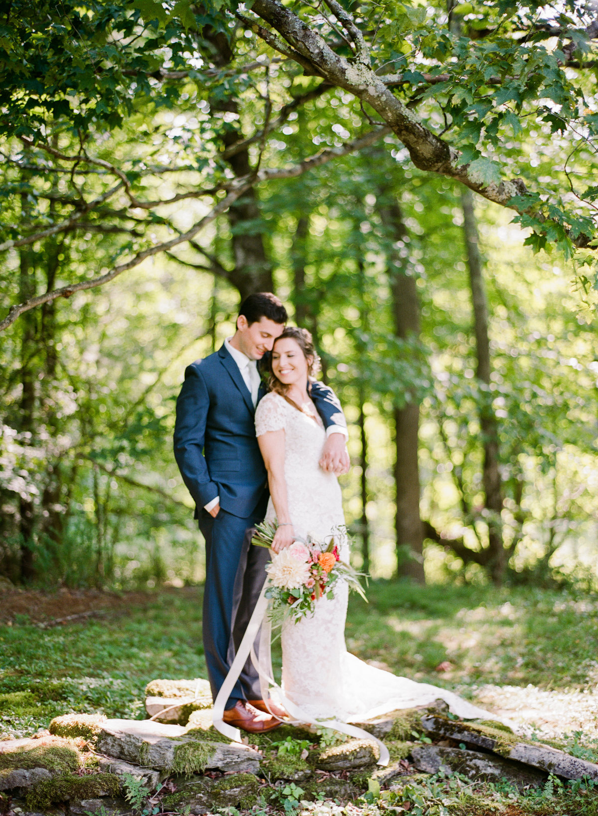 western massachusetts backyard wedding couple on stone wall