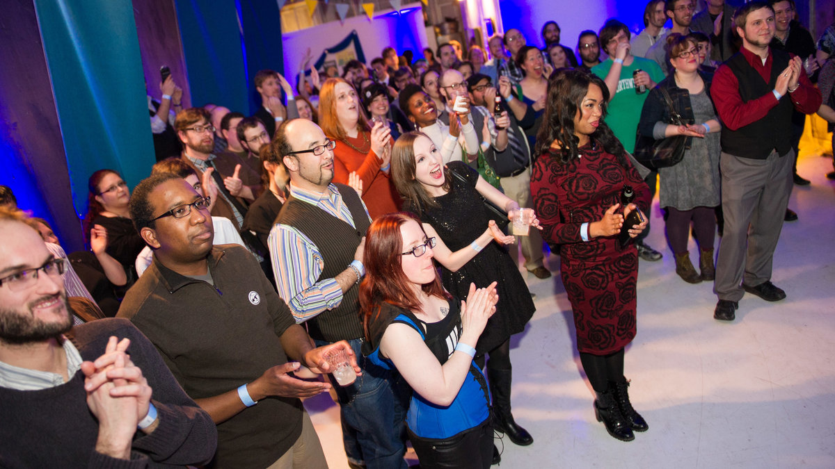 Crowd applauds at Our Fair City launch party, Chicago IL.