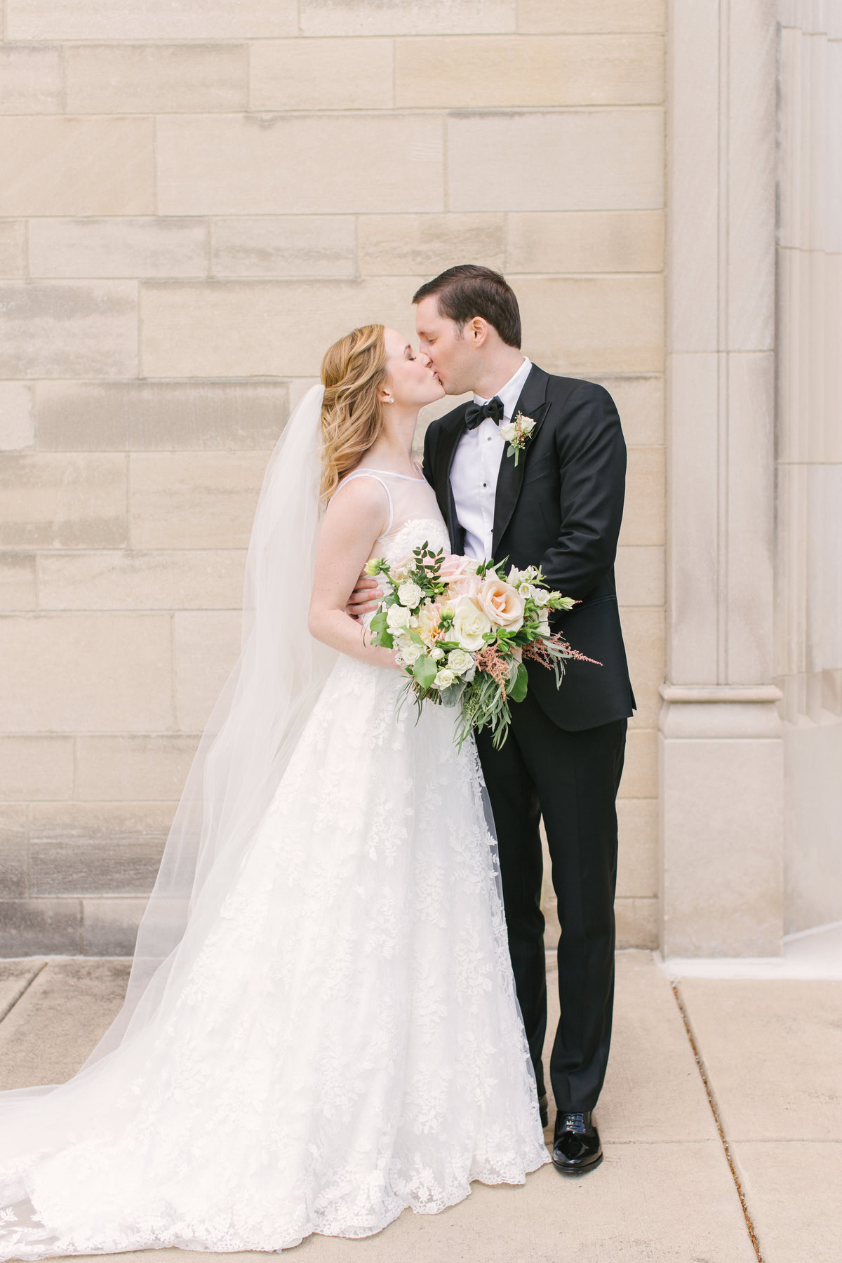 Scottish Rite Cathedral Wedding Bride and Groom Kissing Photo