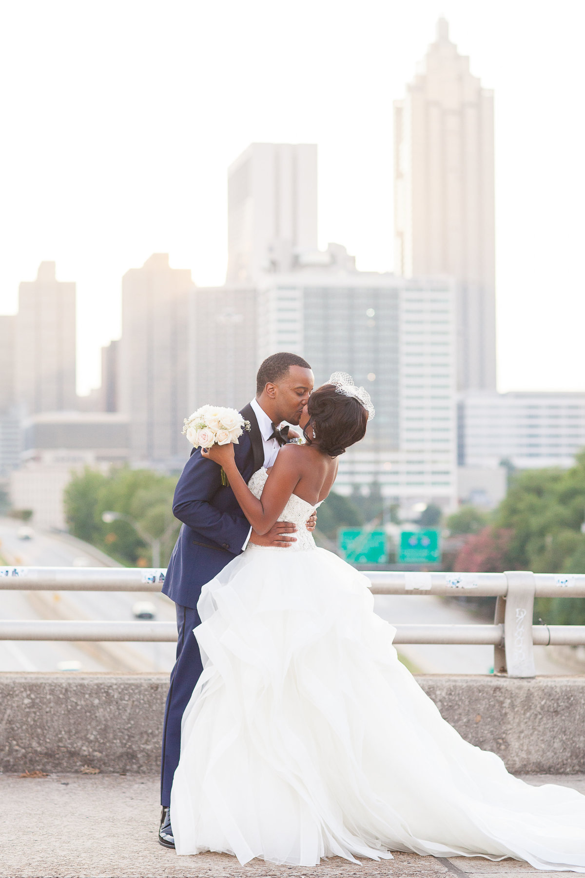 A bride and groom on the Jackson Street Bridge in Atlanta
