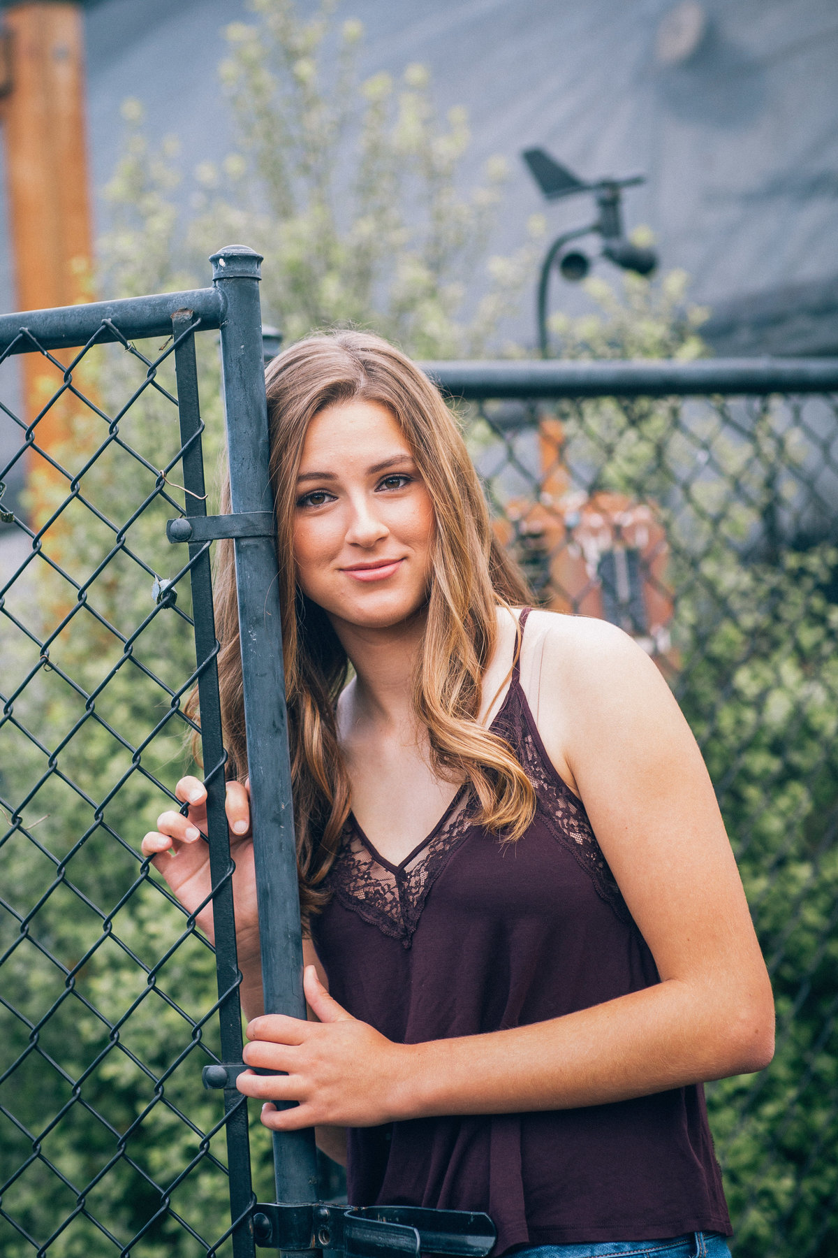 Lake Oswego Senior pictures at Park with Fence