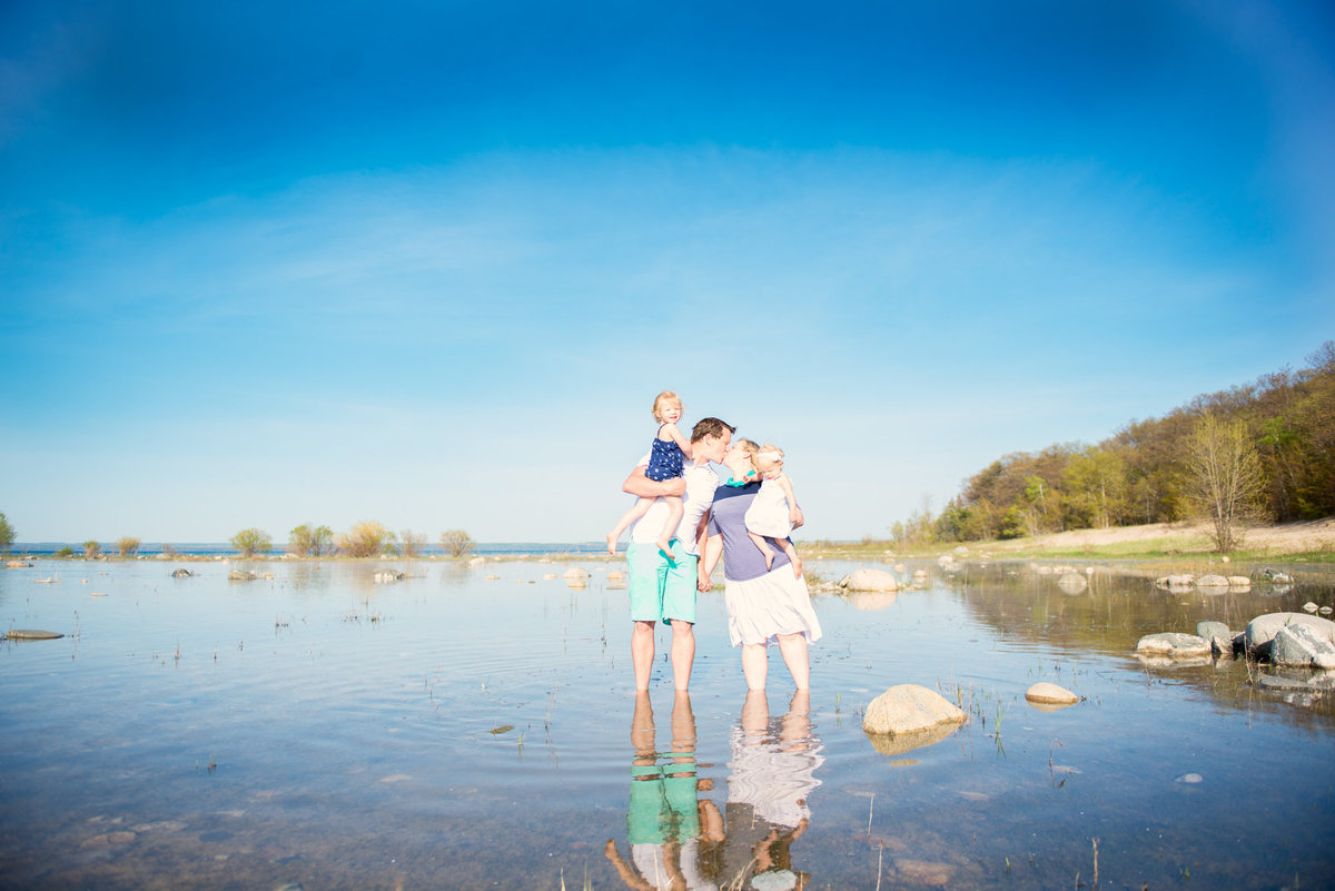 family portrait photographers on the beach of traverse city michigan