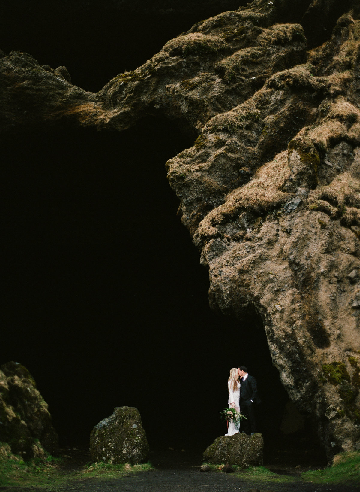 iceland destination wedding elopement couple in cave