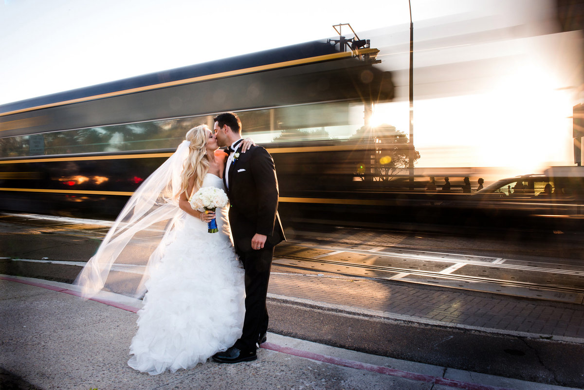 unexpected-wedding-moment-kiss-in-front-of-train-Del-Mar-CA