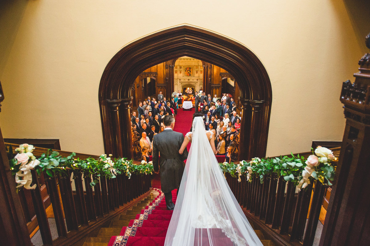 bride walking down the stairs from behind at allerton castle