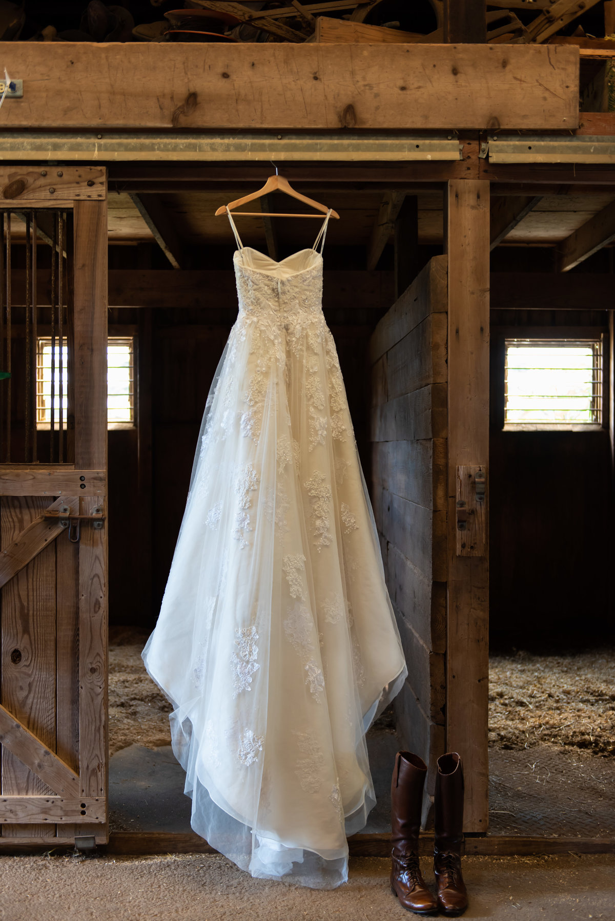 Stunning wedding gown photographed at a stall. Richmond  wedding photographers
