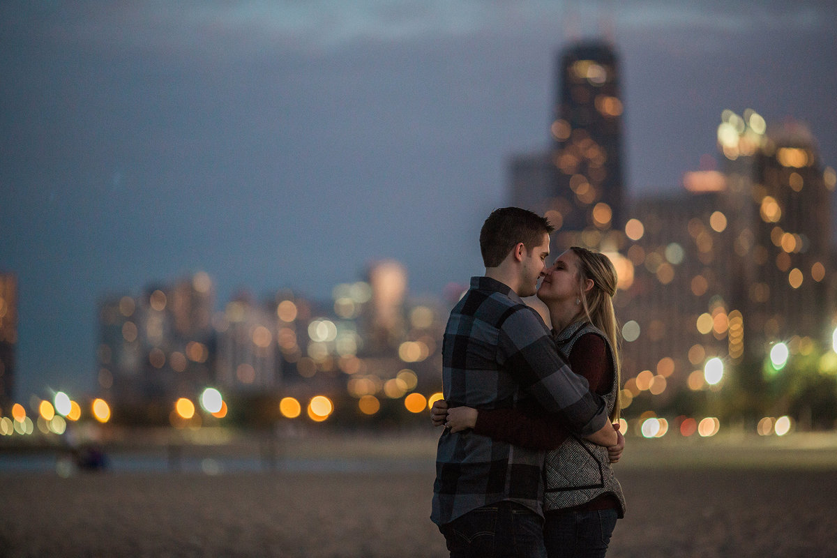engagementphotograph of a couple along lake michigan in chicago illinois