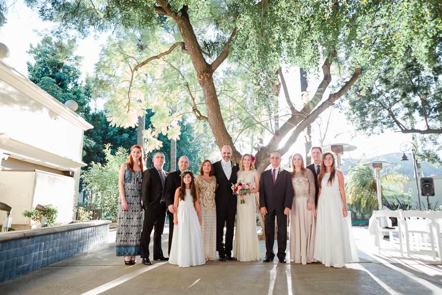 Newly weds portrait with family under a beautiful tree